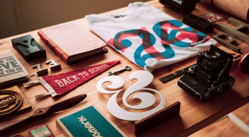 Desk covered in products with visual branding, logos and various typography
