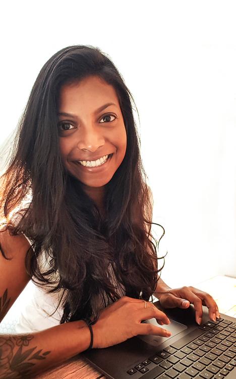 Ruha, web designer and digital strategist, is smiling at the camera
